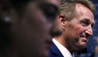 U.S. Sen. Jeff Flake, R-Arizona, talks with guests following an address in Manchester, N.H., Monday, Oct. 1, 2018. Flake, days after a critical vote in support of Supreme Court nominee Brett Kavanaugh, made his second visit this year to New Hampshire. The visit will once again stoke suggestions that he might run against President Trump in 2020. (AP Photo/Charles Krupa)
