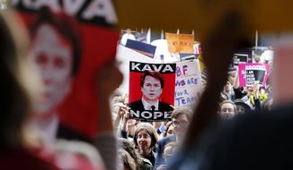 Protesters hold signs at a rally at City Hall ahead of an appearance by Sen. Jeff Flake, R- Ariz., at the Forbes 30 Under 30 Summit, Monday, Oct. 1, 2018, in Boston. (AP Photo/Mary Schwalm)