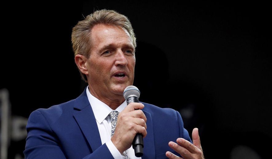Sen. Jeff Flake, R-Ariz., speaks during an appearance at the Forbes 30 Under 30 Summit, Monday, Oct. 1, 2018, in Boston. (AP Photo/Mary Schwalm) ** FILE **