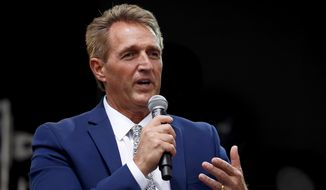 Sen. Jeff Flake, R-Ariz., speaks during an appearance at the Forbes 30 Under 30 Summit, Monday, Oct. 1, 2018, in Boston. (AP Photo/Mary Schwalm)