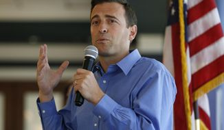 """File - In this Aug. 28, 2018 file photo, Nevada state Attorney General Adam Laxalt speaks at the Southern Hills Republican Women's Club in Henderson, Nev. The Republican gubernatorial candidate said Saturday, Sept. 29, 2018, he was a """"reckless and foolish"""" teen when he was arrested for assaulting a police officer more than 20 years ago in Virginia. Records obtained by the Reno Gazette Journal from the city of Alexandria show the Nevada attorney general was taken into custody for underage drinking in 1996. (AP Photo/John Locher, File)"""