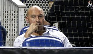 FILE - In this July 2, 2018, file photo, Miami Marlins CEO Derek Jeter watches during the ninth inning of a baseball game against the Tampa Bay Rays, in Miami. Jeter played on a winning team in each of his 20 seasons as a shortstop, which made his first year as an owner a test of patience. He admits he failed. (AP Photo/Wilfredo Lee, File)