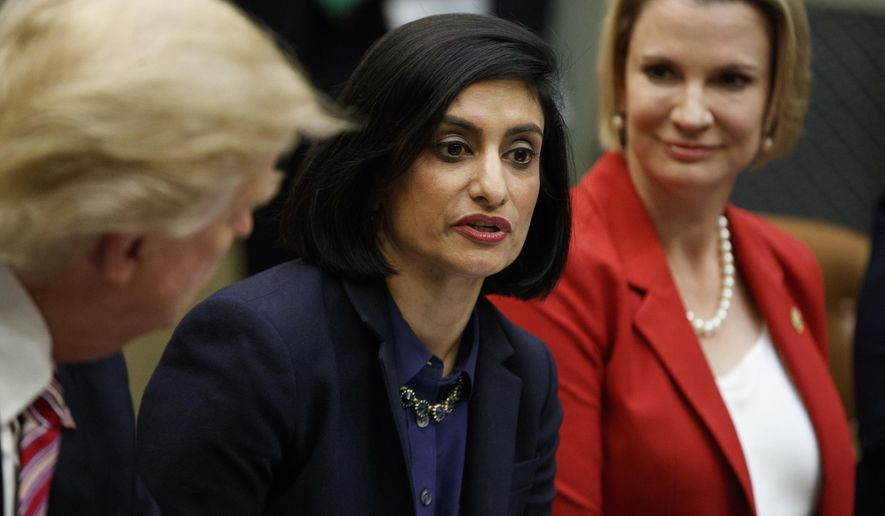 FILE - In this March 22, 2017, file photo, President Donald Trump , left, and Texas State Sen. Dawn Buckingham, right, listen as Administrator of the Centers for Medicare and Medicaid Services Seema Verma speaks during a meeting on women in healthcare in the Roosevelt Room of the White House in Washington. Medicare is modernizing its website to make it more useful for beneficiaries, particularly younger ones already going online for information from insurers, hospitals and doctors. (AP Photo/Evan Vucci, File)