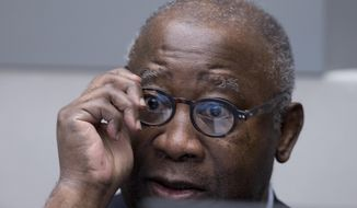 In this Thursday, Jan. 28, 2016 image, former Ivory Coast president Laurent Gbagbo waits for the start of his trial at the International Criminal Court in The Hague, Netherlands. International Criminal Court prosecutors urged judges Monday Oct. 1, 2018, to continue the trial of former Ivory Coast President Laurent Gbagbo and a government ex-minister on trial for their alleged involvement in deadly violence that erupted after the country's disputed 2010 presidential election. (AP Photo/Peter Dejong, Pool)