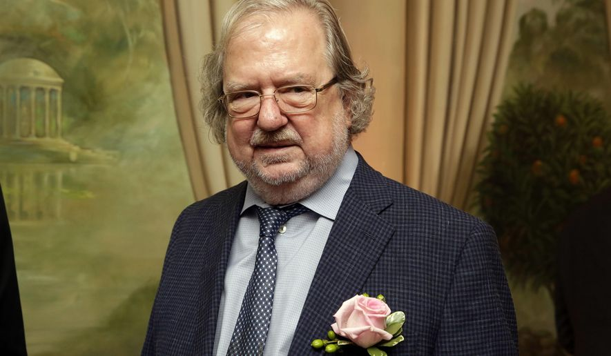 In this Sept. 18, 2015, file photo Dr. James P. Allison, University of Texas MD Anderson Cancer Center, poses for a photo in New York. James P. Allison and Tasuku Honjo are jointly awarded the Nobel Prize in medicine or physiology Monday, Oct. 1, 2018.  (AP Photo/Richard Drew, file)