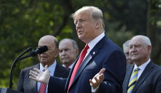 President Donald Trump delivers remarks on trade between the United States, Canada, and Mexico, in the Rose Garden of the White House, Monday, Oct. 1, 2018, in Washington. (AP Photo/Evan Vucci)