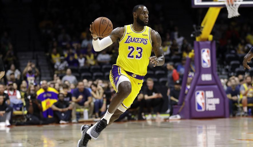 Los Angeles Lakers forward LeBron James dribbles during the first half of an NBA preseason basketball game against the Denver Nuggets, Sunday, Sept. 30, 2018, in San Diego. (AP Photo/Gregory Bull)