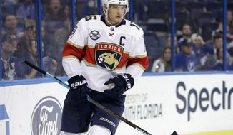Florida Panthers center Aleksander Barkov celebrates his goal against the Tampa Bay Lightning during the third period of an NHL preseason hockey game Tuesday, Sept. 25, 2018, in Tampa, Fla. The Panthers won the game 3-2. (AP Photo/Chris O'Meara)