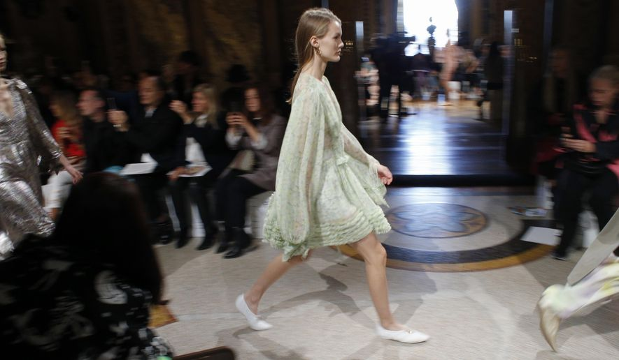 A model wears a creation for Stella McCartney Spring/Summer 2019 ready-to-wear fashion collection presented in Paris, Monday, Oct.1, 2018. (AP Photo/Thibault Camus)
