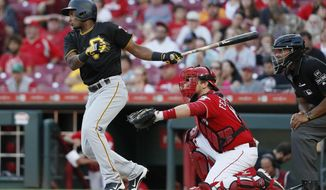 Pittsburgh Pirates' Pablo Reyes hits a double off Cincinnati Reds relief pitcher Jackson Stephens in the 10th inning of a baseball game, Sunday, Sept. 30, 2018, in Cincinnati. (AP Photo/John Minchillo)