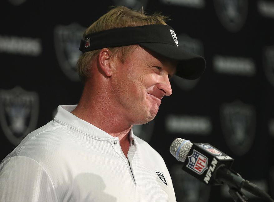 FILE - In this Sunday, Sept. 30, 2018, file photo, Oakland Raiders head coach Jon Gruden smiles during a news conference after a 45-42 win in overtime against the Cleveland Browns in an NFL football game, in Oakland, Calif. (AP Photo/Ben Margot, File)
