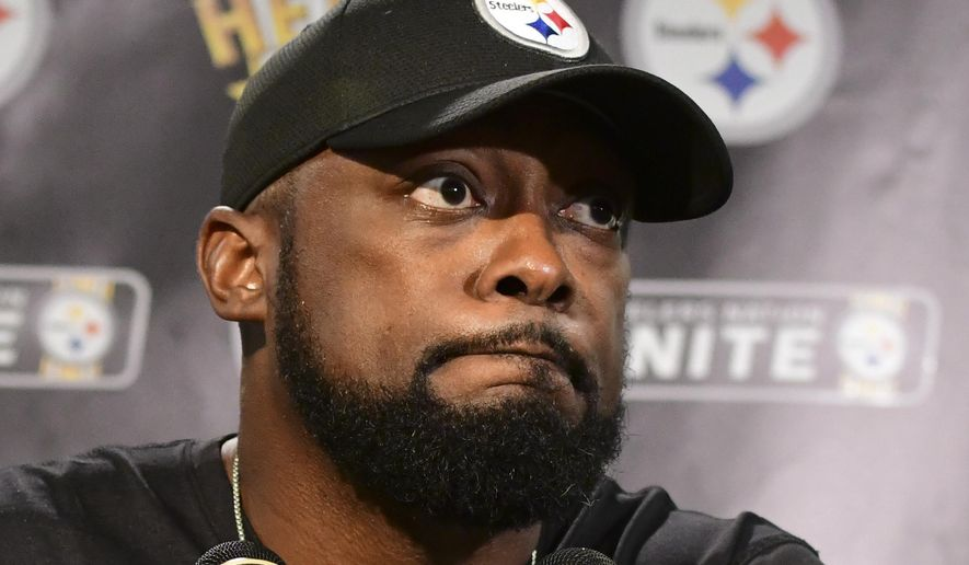 Pittsburgh Steelers head coach Mike Tomlin listens to a question while meeting with reporters following a 26-14 loss to the Baltimore Ravens in an NFL football game in Pittsburgh, Sunday, Sept. 30, 2018. (AP Photo/Fred Vuich)