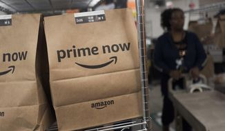 In this Dec. 20, 2017, file photo, Prime Now customer orders are ready for delivery at the Amazon warehouse in New York. Same-day delivery promises the convenience of online ordering with nearly the same immediacy of store buying. (AP Photo/Mark Lennihan, File)