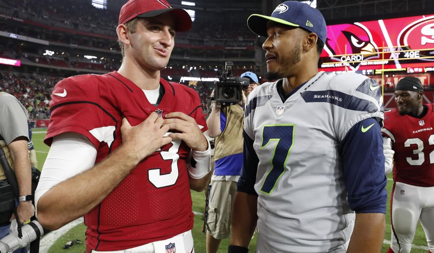 Arizona Cardinals quarterback Josh Rosen (3) talks with Seattle Seahawks quarterback Brett Hundley (7) after an NFL football game, Sunday, Sept. 30, 2018, in Glendale, Ariz. The Seahawks won 20-17. (AP Photo/Rick Scuteri)