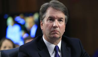 In this Sept. 4, 2018, photo, Supreme Court nominee Brett Kavanaugh, listens to Sen. Cory Booker, D-N.J., speak during a Senate Judiciary Committee nominations hearing on Capitol Hill in Washington. (AP Photo/Manuel Balce Ceneta, File)