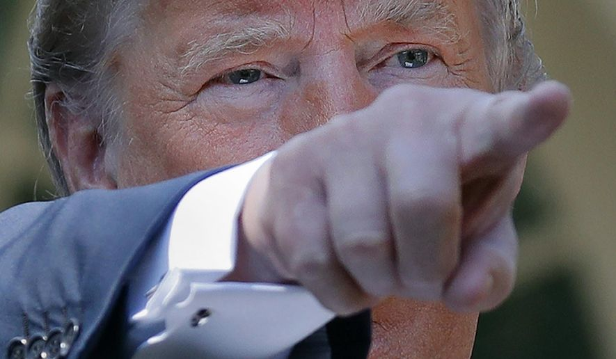 President Donald Trump points to a member of the media as he speaks on trade between the United States, Canada, and Mexico, in the Rose Garden of the White House, Monday, Oct. 1, 2018, in Washington. (AP Photo/Pablo Martinez Monsivais)
