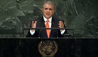 Colombia's President Ivan Duque Marquez addresses the 73rd session of the United Nations General Assembly, at U.N. headquarters, Wednesday, Sept. 26, 2018. (AP Photo/Richard Drew)