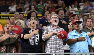 Local fans recite the Pledge of Allegiance at a MAGA rally before President Trump speaks in Johnson City, Tennessee, on Monday. (Associated Press)