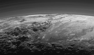 This July 14, 2015 photo released by NASA on Thursday, Sept. 17, 2015 shows the atmosphere and surface features of Pluto, lit from behind by the sun. It was made 15 minutes after the New Horizons' spacecraft's closest approach. (NASA/JHUAPL/SwRI via AP)