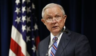 Attorney General Jeff Sessions speaks during a press conference Tuesday, Oct. 2, 2018, at the U.S. Attorney's Office in Columbus, Ohio, where he announced federal racketeering charges against 19 alleged gang members in Ohio in a conspiracy involving murder, attempted murder and drug trafficking. (Adam Cairns/The Columbus Dispatch via AP)