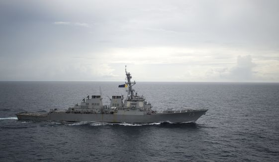"The Navy's guided missile destroyer USS Decatur was operating in the South China Sea as part of the Bonhomme Richard Expeditionary Strike Group when a Chinese destroyer came aggressively close, forcing the U.S. ship to maneuver to prevent a collision. The Chinese warship approached the USS Decatur in an ""unsafe and unprofessional maneuver,"" said Lt. Cmdr. Tim Gorman, spokesman for the U.S. Pacific Fleet. (Associated Press)"