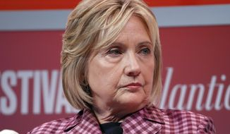 Former Secretary of State Hillary Clinton listens to question from Jeffrey Goldberg, editor in chief of The Atlantic, during The Atlantic Festival, Tuesday, Oct. 2, 2018, in Washington. (AP Photo/Alex Brandon)