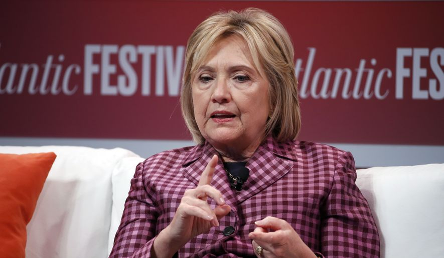 Former Secretary of State Hillary Clinton talks with Jeffrey Goldberg, editor in chief of The Atlantic, during The Atlantic Festival, Tuesday, Oct. 2, 2018, in Washington. (AP Photo/Alex Brandon)