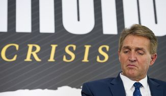 Sen. Jeff Flake, R-Ariz. participates in an interview at the The Atlantic's 'The Constitution in Crisis' forum in Washington, Tuesday, Oct. 2, 2018.  (AP Photo/Cliff Owen)