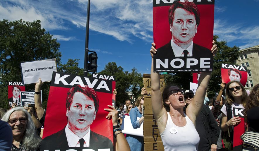 Protesters rally against Supreme Court nominee Brett Kavanaugh as the Senate Judiciary Committee debates his confirmation, Friday, Sept. 28, 2018, at the Supreme Court in Washington. (AP Photo/Jose Luis Magana)