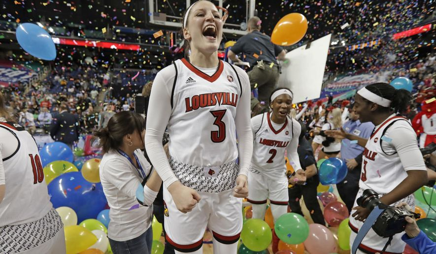 FILE - In this March 4, 2018, file photo, Louisville's Sam Fuehring (3) celebrates with teammates after an NCAA college basketball game against Notre Dame in the championship of the women's Atlantic Coast Conference tournament, in Greensboro, N.C. Both Notre Dame and Louisville enter the season as defending women's basketball champions. (AP Photo/Chuck Burton, File)