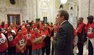 John Boardman, executive secretary-treasurer of Unite Here, Local 25, addresses D.C. hotel workers and other union members after the D.C. Council gave preliminary approval to legislation to limit Airbnb rentals on Oct. 2, 2018. He called the vote a victory. (Photo by Julia Airey / The Washington Times)