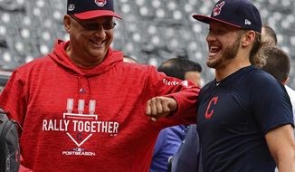Cleveland Indians manager Terry Francona, left, and infielder Josh Donaldson laugh during a baseball team workout, Tuesday, Oct. 2, 2018, in Cleveland. The Indians will play the Houston Astros Friday in Game 1 of the AL Division Series. (AP Photo/David Dermer)