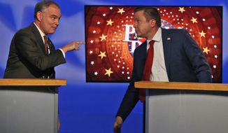 U.S. Senator Tim Kaine, D-Va., left, points to Republican challenger Corey Stewart after their final debate in Richmond, Va., Tuesday, Oct. 2, 2018. (AP Photo/Steve Helber)