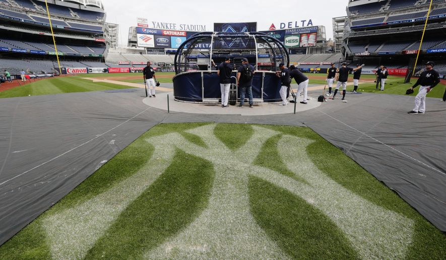 New York Yankees players take batting practice during a team workout before their upcoming American League wildcard baseball game against the Oakland Athletics Tuesday, Oct. 2, 2018, in New York. (AP Photo/Frank Franklin II)