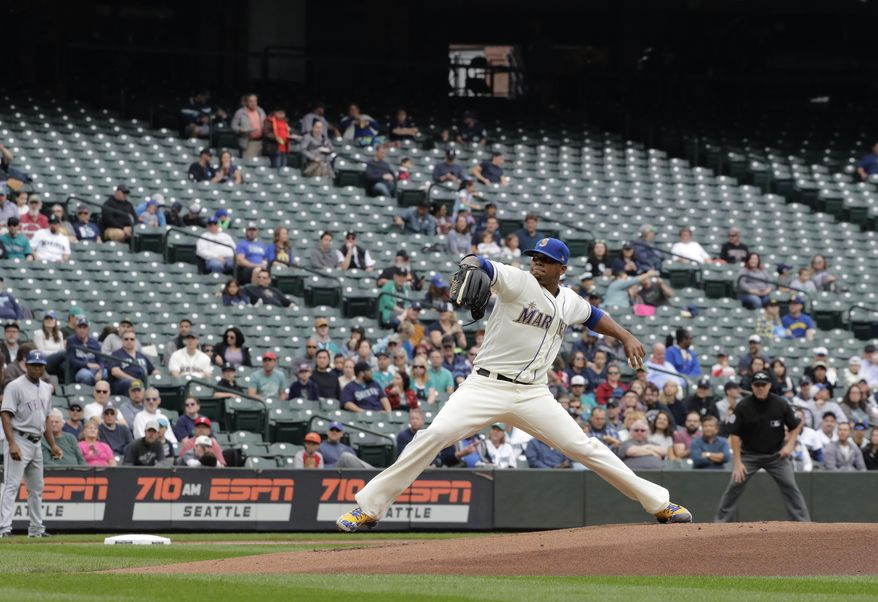 FILE - In this Sept. 30, 2018, file photo, empty seats are shown at Safeco Field as Seattle Mariners starting pitcher Roenis Elias throws against the Texas Rangers during the first inning of a baseball game, in Seattle. Major League Baseball's attendance dropped to its lowest level since 2003, and six stadiums set record lows. (AP Photo/Ted S. Warren, File)