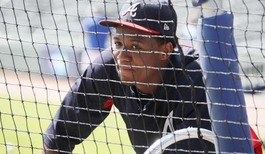 Atlanta Braves' Ronald Acuna Jr. waits for his turn in the batting cage during a baseball workout, Tuesday, Oct. 2, 2018, in Atlanta. The Braves face the Los Angeles Dodgers in the National League division series starting on Thursday, Oct. 4 in Los Angeles. (Bob Andres/Atlanta Journal-Constitution via AP)
