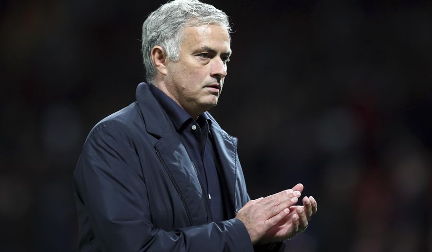 ManU coach Jose Mourinho leaves the field at the end of the Champions League group H soccer match between Manchester United and Valencia at Old Trafford Stadium in Manchester, England, Tuesday Oct. 2, 2018. (AP Photo/Jon Super)