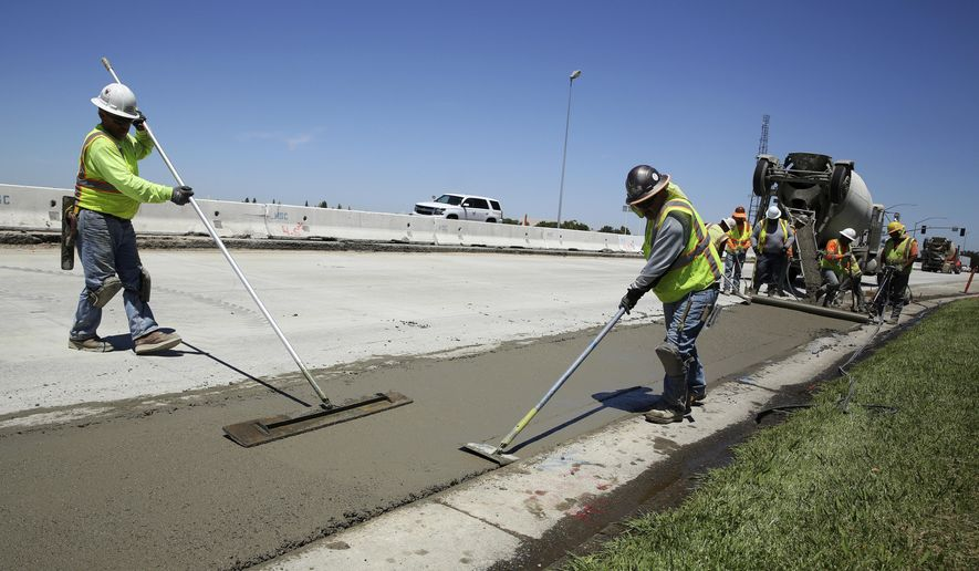FILE In this July 11, 2018 file photo, workers repave a street in Roseville, Calif., partially funded by a gas tax hike passed by the Legislature in 2017. Leaders of the Proposition 6 campaign to repeal California's recent gas tax increase are asking the federal government to investigate their claims that public resources have been used against them. A spokeswoman for the anti-Proposition 6 campaign countered the allegations, saying the campaign follows all laws. (AP Photo/Rich Pedroncelli, File)