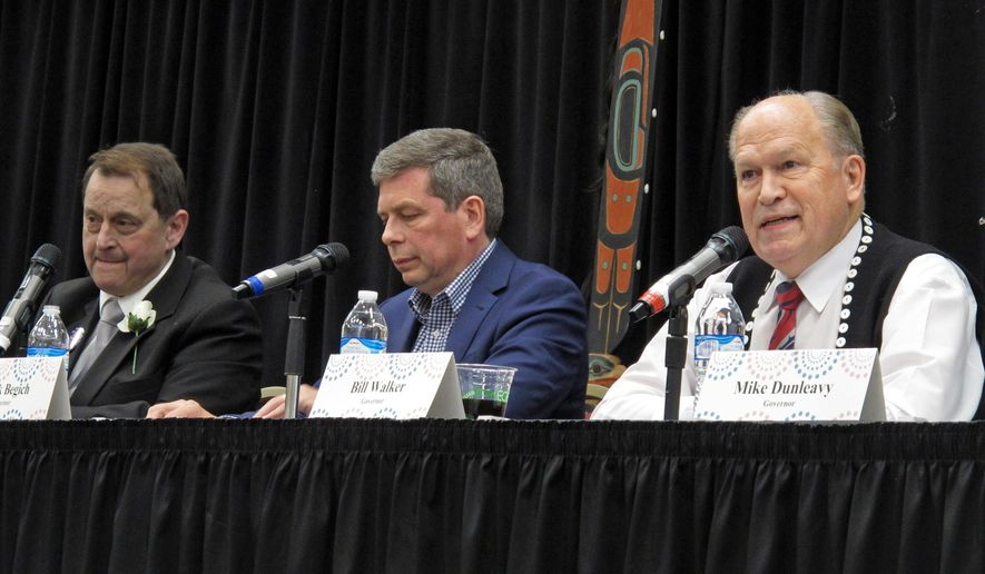 Alaska Gov. Bill Walker, right, speaks during a candidate forum on Tuesday, Oct. 2, 2018, in Juneau, Alaska. Also pictured, from left, are Libertarian Billy Toien and Democrat Mark Begich, center. Republican Mike Dunleavy did not attend. (AP Photo/Becky Bohrer)