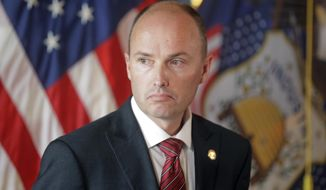 FILE - In this May 19, 2017, file photo, Utah Lt. Gov. Spencer Cox looks on during a news conference at the Utah State Capitol, in Salt Lake City. Mitt Romney's Senate candidacy in Utah is adding urgency to election officials' work to beef up security and guard against the threat of voting interference from Russian hackers. Cox said Tuesday, Oct. 2, 2018, the presence of the onetime presidential candidate and Russia critic on the ballot is among the reasons why the state is taking extra steps to ensure the Nov. 6 midterm election is secure. (AP Photo/Rick Bowmer, File)