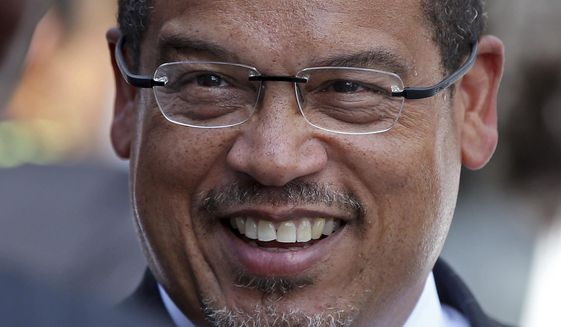 In this Sept. 14, 2018 photo, U.S. Rep. Keith Ellison is shown in Minneapolis. A Minnesota prosecutor says he'll review allegations of domestic abuse against Ellison only if a formal complaint is first investigated by law enforcement. An ex-girlfriend of Ellison, Karen Monahan, alleges the Democratic congressman dragged her off a bed by her feet in 2016. (AP Photo/Jim Mone)