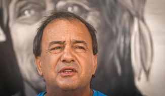 FILE - This Sept. 1, 2018 file photo shows mayor of the Calabrian town of Riace, southern Italy, Domenico Lucano. On Tuesday, Oct. 2, 2018, Italian financial police placed Lucano, who has become a symbol for welcoming migrants to Italy, under house arrest for allegedly aiding illegal immigration. (Cesare Abbate/ANSA via AP, file)