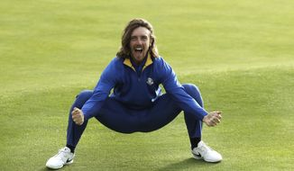 Europe's Tommy Fleetwood celebrates after Europe won the Ryder Cup on the final day of the 42nd Ryder Cup at Le Golf National in Saint-Quentin-en-Yvelines, outside Paris, France, Sunday, Sept. 30, 2018. (AP Photo/Matt Dunham)