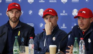 U.S. players Dustin Johnson, left, Jordan Spieth and Brooke Koepka team attends the press conference of the losing team after Europe won the 2018 Ryder Cup golf tournament at Le Golf National in Saint Quentin-en-Yvelines, outside Paris, France, Sunday, Sept. 30, 2018. (AP Photo/Alastair Grant) ** FILE **