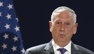 U.S Defense Secretary Jim Mattis speaks during a joint press conference with his French counterpart Florence Parly in Paris, Turesday, Oct.2, 2018. (AP Photo/Christophe Ena)