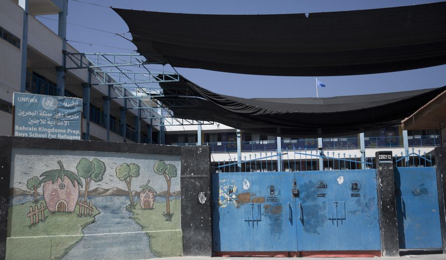 A painting adorns a wall at a closed United Nations Relief and Works Agency (UNRWA) school during a general strike by UN staff, in Gaza City, Monday, Sept. 24, 2018. (AP Photo/Khalil Hamra)