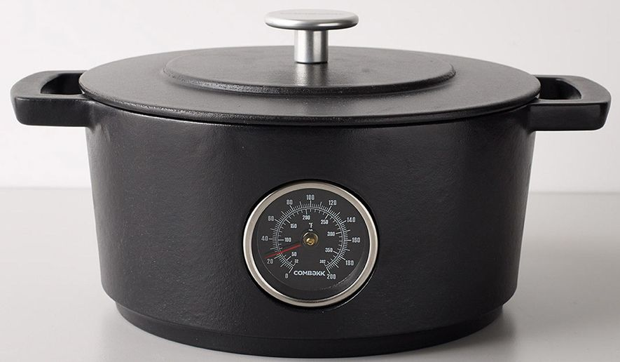 This photo provided by the MoMA Design Store shows the Railway Dutch Oven. Available at the Museum of Modern Art's store, and made in Holland of recycled iron tracks, the Railway Dutch Oven has a handy thermometer built in to help monitor the cooking progress. (MoMA Design Store via AP)