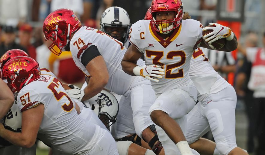 Iowa State running back David Montgomery (32) looks for some running room in the first half of a NCAA college football game against TCU in Fort Worth, Texas, Saturday, Sept. 29, 2018. (Bob Booth/Star-Telegram via AP)
