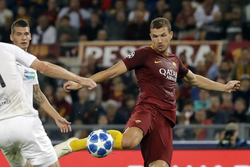 Roma forward Edin Dzeko, center, shots on goal to score his side second goal during the Champions League, group G soccer match between Roma and Viktoria Plzen at the Rome Olympic Stadium, in Rome, Italy, on Tuesday, Oct. 2, 2018. (AP Photo/Andrew Medichini)