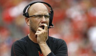FILE - In this Sept. 1, 2018, file photo, Maryland interim head coach Matt Canada walks on the sideline in the first half of an NCAA college football game against Texas in Landover, Md. Following a Big Ten victory and a bye, Maryland faces its toughest test yet _ a matchup against No. 15 Michigan at the Big House. (AP Photo/Patrick Semansky, File)